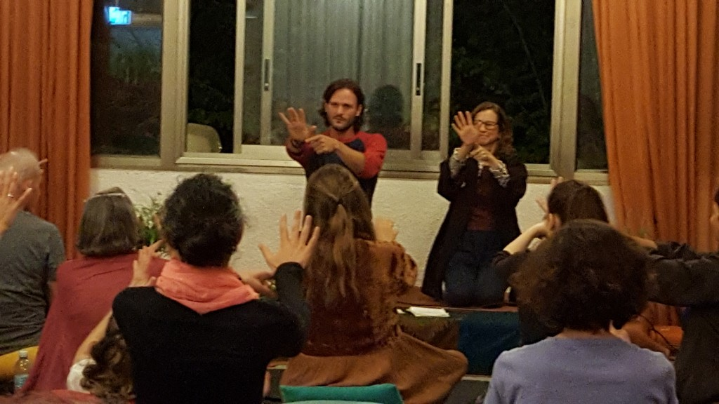 Mick Neustadt and Cary Jacoby at an evening presentation on transformation and healing