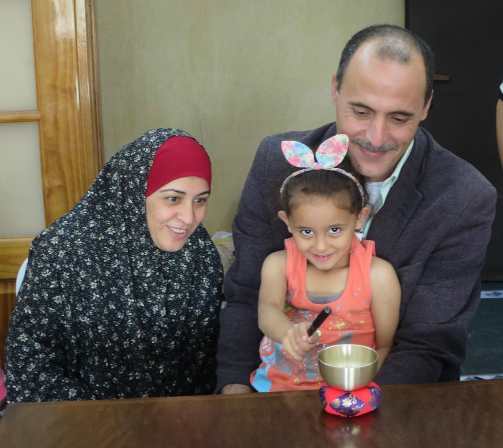 Issa and his wife and daughter, with the bell we had brought them.