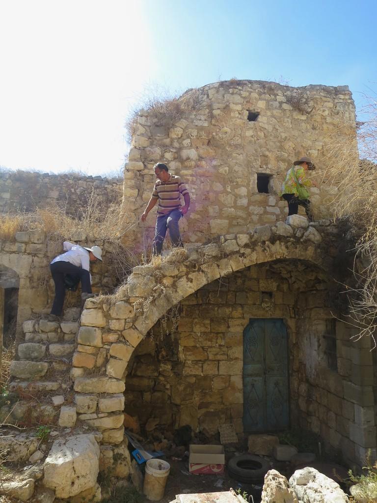 Ann-Mari, Lynda, and our guide in historic Deir Istiya.